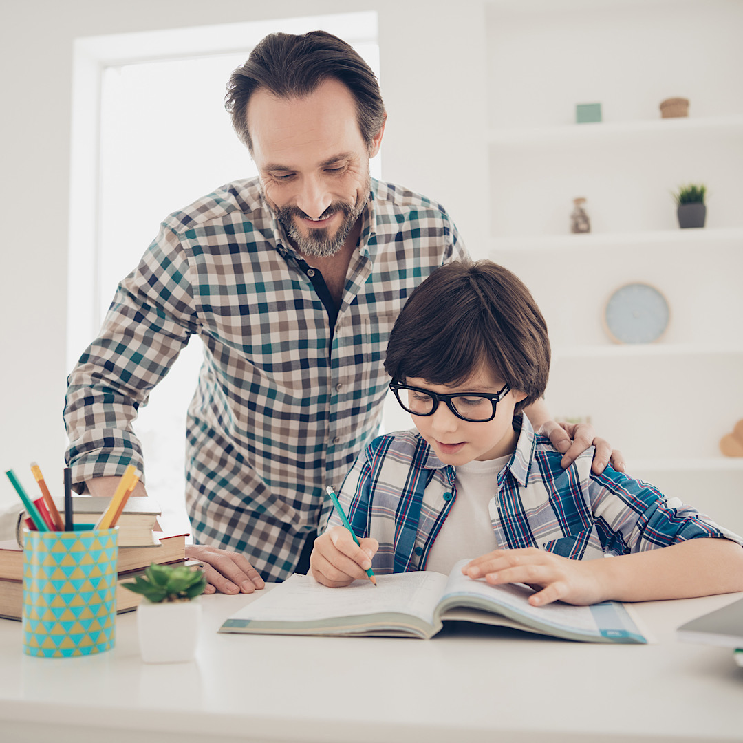 Using best method of studying subjects concept. Photo of clever patient, intellectual mature daddy helping his son with hometask preparation and exams