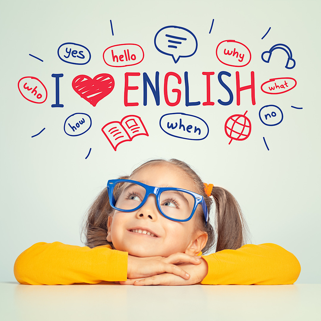 Beautiful cute little girl with eyeglasses looking at the illustrations and words in english above her head. Foreign language learning concept. i love english.